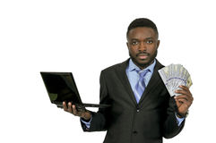 Man with computer and cash. Handsome man with cash using a computer stock photos
