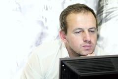 Man at the computer Stock Image