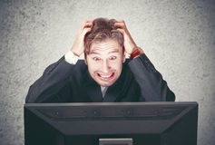 Man at the computer fails, stress, depression Royalty Free Stock Image