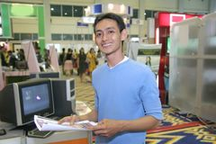 Man in computer fair Stock Photo