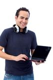 Man with computer and headphones Royalty Free Stock Image