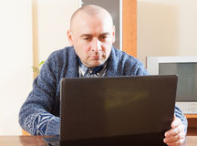 Man at computer in home stock image