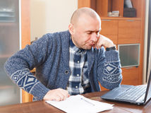 Man at computer in home royalty free stock photo