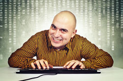 Man with computer keybaord Stock Photo