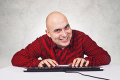 Man with computer keybaord Royalty Free Stock Image