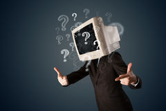 Man with a computer monitor head and question marks Royalty Free Stock Photos