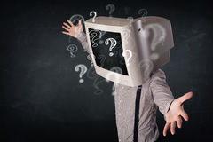 Man with a computer monitor head and question marks Stock Photos
