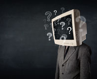 Man with a computer monitor head and question marks Stock Photo