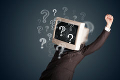 Man with a computer monitor head and question marks Royalty Free Stock Photo