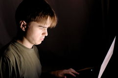 Man at the computer at night Royalty Free Stock Image