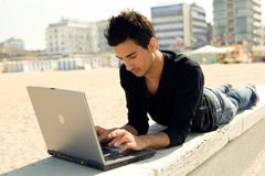 Man with computer outdoor Stock Images