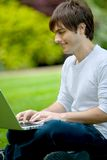 Man with a computer outdoors Stock Photography
