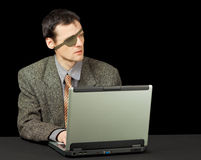 Man - computer pirate with laptop Stock Images