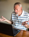 Man and computer Stock Photography
