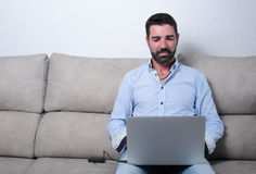 Man with a computer. In social networks stock image