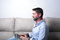 Man with a computer Stock Image