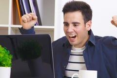 Man computer success. Man smiling with computer laptop, success Stock Photo