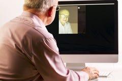 Man at Computer Royalty Free Stock Image