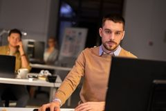 Man with computer working late at night office royalty free stock photo