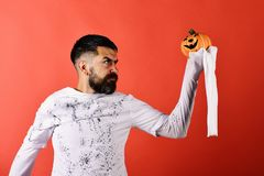 Man with concentrated face on red background. Guy with beard royalty free stock photos