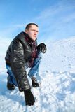 Man concentrated looks winter of squatting in sky Stock Photography