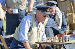 Man concentrating on  chess awaiting scramble in World War Two reenactment Stock Photography