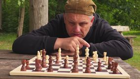 Man concentrating on chess stock video footage