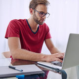 Man concentrating on getting his work done Royalty Free Stock Images