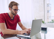 Man concentrating on getting his work done Royalty Free Stock Image