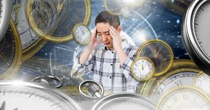 Man concentrating with Surreal Time and space clock concept stock photography