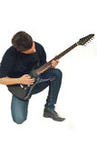Man concentration with guitar Stock Images