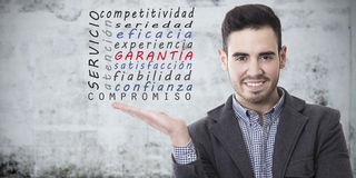 Quality and guarantee. Man with the concepts of quality and guarantee Royalty Free Stock Photo