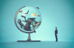 Man concerned by a globe Stock Photo