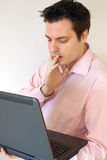 Man concerned on laptop Royalty Free Stock Photography