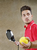 Man in concrete court ready for paddle tennis serve Stock Image