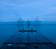 Man and concrete pier. Man standing on the concrete pier near the sea Royalty Free Stock Photo