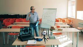 A man is conducting an online class for multiple users. On-line class, remote studying concept.