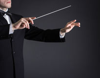 Man conducting an orchestra Stock Photo