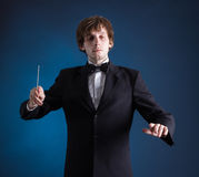 Man conducting an orchestra Stock Images