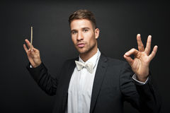 Man conducting an orchestra Royalty Free Stock Image