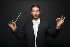 Man conducting an orchestra Royalty Free Stock Photo