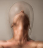 Man confined to a bubble. Nightmare with man suffering from schizophrenia and cloistered in his own bubble stock images