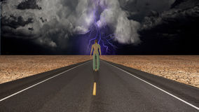 Man confronts storm Royalty Free Stock Photography