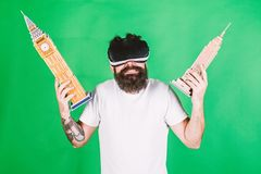 Man on confused face study architecture or design in virtual reality. 3D design concept. Man with beard in VR glasses stock image