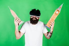 Man on confused face study architecture or design in virtual reality. 3D design concept. Man with beard in VR glasses. Green background. Guy in VR glasses royalty free stock photos