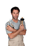 Man confused by work tools Stock Photography