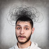 Man with confusing tangle of thoughts Stock Photos
