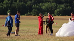 Man congratulate the first Skydiving. Have fun stock footage