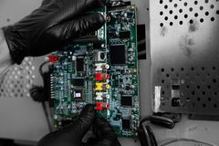 Man connecting a circuit board on a television. Man connecting a circuit board on a flat screen television stock photography