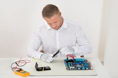 Man Connecting Harddisk With The Motherboard Royalty Free Stock Photography